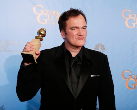 "Director Quentin Tarantino holds the award for Best Screenplay - Motion Picture for ""Django Unchained"" backstage at the 70th annual Golden Globe Awards in Beverly Hills"