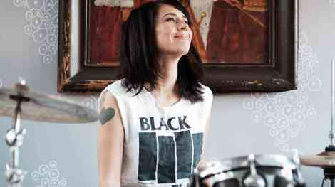 -3---kathleen-hanna-playing-the-drums.-photo-courtesy-of-allison-michael-orenstein_wide-85e15369ca3aa6f644dc72a1eb270345a5ba78e9-s6-c30